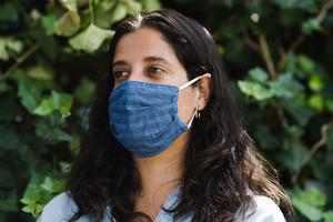 Latina woman wearing face mask outside