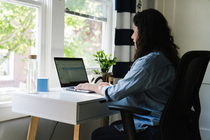 Latina woman working from home on her computer