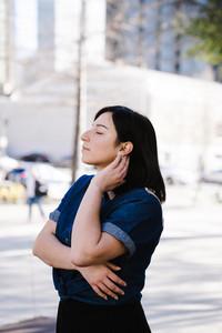 latino woman breathes in fresh air