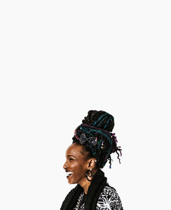 laughing black woman with colorful dreadlocks