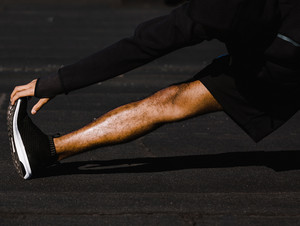 leg stretches out on pavement