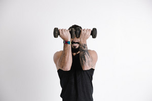 man lifts up two weights