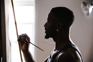 Man painting on canvas