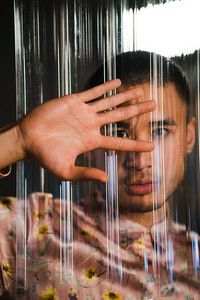 man performs sign language through window