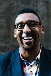 Man smiling outside