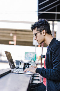 man works on his laptop remotely