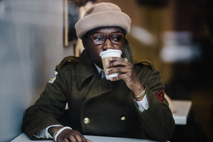 mans sips on hot coffee in cafe