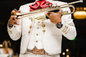 Mexican ma holding trumpet in mariachi band