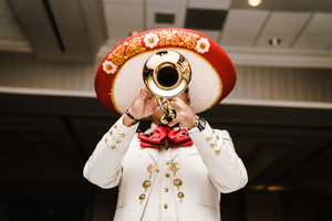 Mexican man playing trumpet in mariachi band