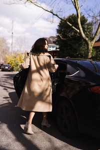 Mixed race woman going into her car