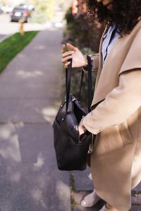 Mixed race woman shuffling through her purse