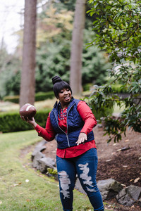 mom plays football with her children