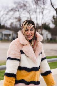 Muslim woman models in a puffy coat