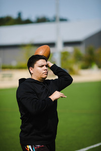 native american man about to throw football