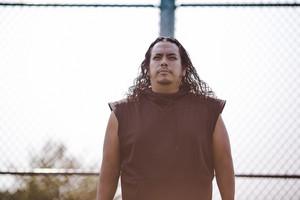 native american man coaching football outside