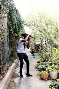 Nigerian man photographing plants