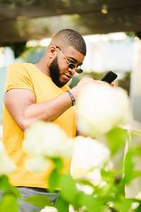 Nigerian man using his phone