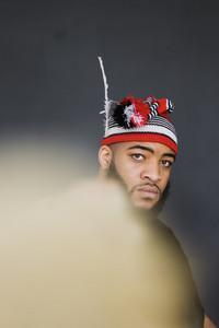 Nigerian man wearing a red kufi