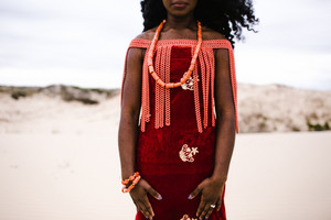 Nigerian woman wearing traditional wedding jewelry