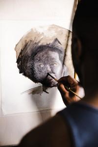 painting a portrait of a Black woman