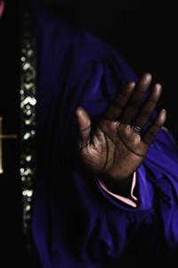 Pastor raising his hand