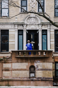 person standing in front of a brown building