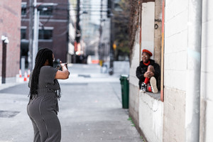 photographer and model take pictures outside
