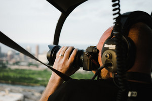Pilot taking pictures while flying helicopter