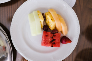 plate of grapes, melon and pineapple