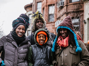 smiling black family on winter vacation