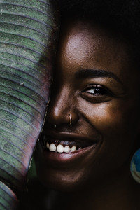 smiling nigerian woman in rain forest