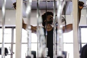 Strong black man lifting weights
