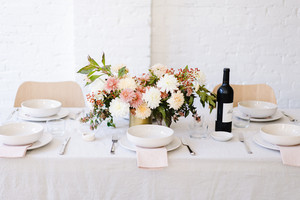 table is set with pink and white decor