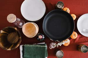 Tablescape of plates, bowls, towels and trinkets