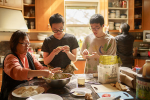 Taiwanese family making dumplings