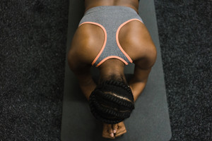 top view of a Black woman in a plank position