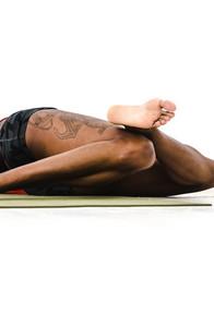 woman does a leg stretch
