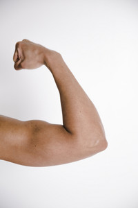 woman flexes her muscles