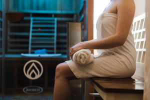 woman gets a spa treatment in a wellness center