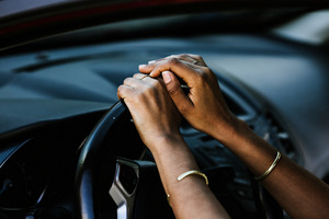 woman hands on a steering wheel