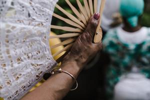 Woman holding fan
