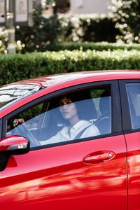 woman looks out open window of car