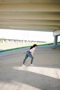 woman prepares to jog outside