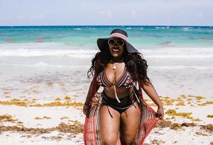 woman walking on beach in bathing suit