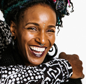 Woman with curly braids laughing