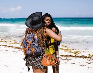 women hug on the beach