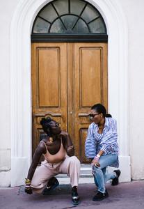 women posing in front of the door