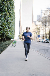 women power walks on the sidewalk
