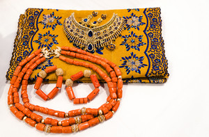 yellow african fabric and orange necklace