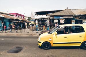 Yellow car driving in Ghana